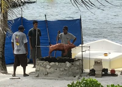 Canary Cove Staff Slow Roast a Pig Onsite While Guests Go Sailing